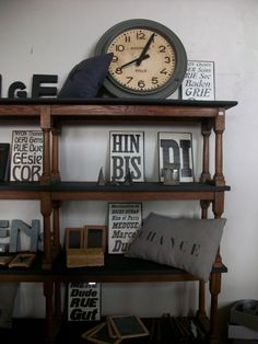 Love the shelves and the old clock.