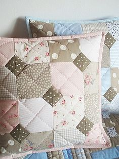 Lovely quilted pillows  No tutorial but a lovely pattern and material for throw pillows to be inspired by.