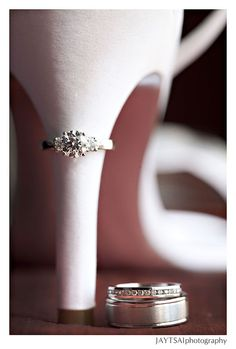 Picture. Except both of hers rings on the heel and his leaning against the heel