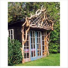 Rustic summerhouse decorated with recycled fallen timber.