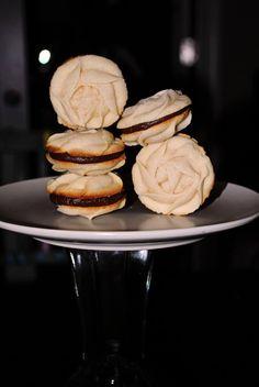 Spritz cookies filled with ganache.