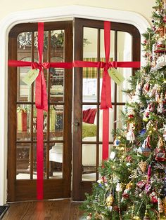 Too early to pin a Christmas idea?  oops!  Turn interior doors into unexpected presents! More fun ideas: http://www.bhg.com/christmas/indoor-decorating/quick-and-easy-holiday-wall-decor/