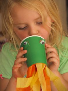 """Paper cup dragon - Lots of fun, however only poke a hole the size of a child's pinky finger into the bottom of the cup.  Glue tissue """"fire"""" around the cups opening.  The """"fire"""" blows better with a small hole versus cutting the whole bottom out! Castle Activities For Kids, Dragon Crafts For Preschool, Castle Crafts For Kids, Googly Eyes, Princess Crafts Preschool, Preschool Dragon, Castle Crafts Preschool, Paper Cup Crafts For Kids, Paper Cups"""