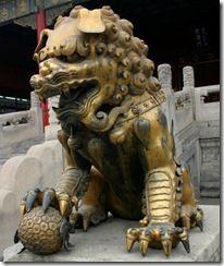 Male Fu Dog holding the World. Forbidden City.