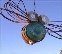 recycled garden, glass insulator crafts, insul art, antique glass insulators, garden art, telephone insulators, glass insulator projects, insulator ideas, garden bugs