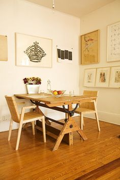old drafting table as dining table (cool idea)