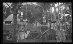 Portrait of two men and a women, wearing traditional Samoan headdress and ornaments. Creator/Contributor: Lambert, Sylvester Maxwell, 1882-1947, Photographer Date:between 1919 and 1939 Contributing Institution: UC San Diego, Mandeville Special Collections Library