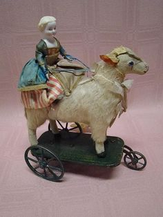 Ruby Lane-Antique Mechanical Toy with Bisque Lady Riding a Paper Mache Lamb. Learn about your collectibles, antiques, valuables, and vintage items from licensed appraisers, auctioneers, and experts at Blue Vault. Visit: http://www.bluevaultsecure.com/roadshow-events.php