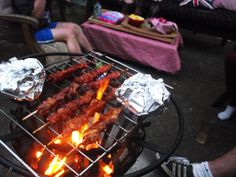 Greatfun4kids: Cowboy cookout - food cooked on a brazier or fire pit in the backyard... marionated chicken skewers, sausages on sticks and garlic pita bread wrapped in foil