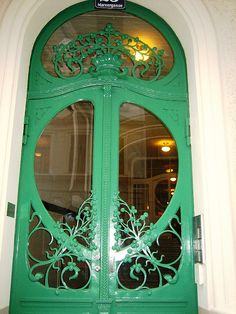 Green Art Nouveau door. Austria