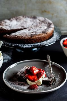 Flourless Chocolate torte with macerated strawberries {From Simply Delicious}