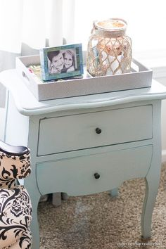 Chalk like finish painted ice blue table using Paint Minerals and Valspar sample paint pots