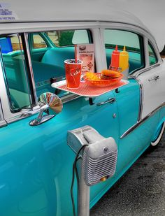 Pull in to a drive-in restaurant, and  a car-hop rushed to your window, took your order, then returned with your food.  Or, you placed your order on the speaker and the car hop brought it out. memori, school, 1950s, rememb, tray, nostalgia, root beer, diner, fast foods