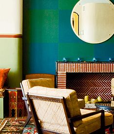 Green and Turquoise Patterned Squares on Wall with Round Mirror  D Magazine