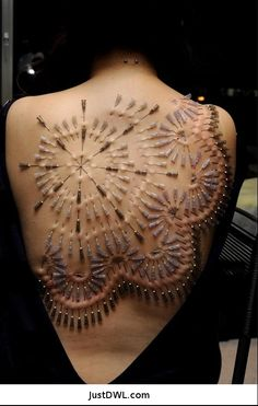 Needle Body Art.. Those needles come out folks..that is temporary ..