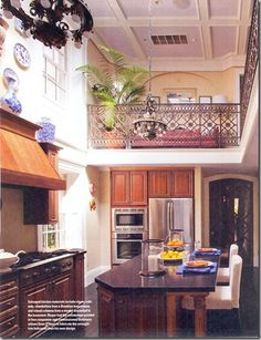 Two story kitchen space.