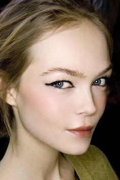 Porcelain skin and bold black eyeliner
