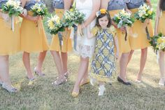 Love the bridesmaid dresses, love the flower girl, love it all!  a must-see yellow and grey modernly classic wedding at home | photos by miles witt boyer