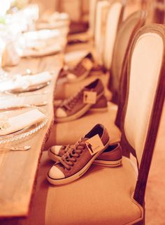 leave a pair of shoes on the seats for the groomsmen/ bridesmaids to change into at the reception