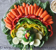 Feeling kitschy? Make a turkey centerpiece entirely out of vegetables: | 21 Centerpieces You Can Easily DIY thanksgiving turkey, thanksgiv veggi, vegetable trays, turkey veggi, bell peppers, veggie tray, thanksgiving appetizers, food allergies, veggi platter