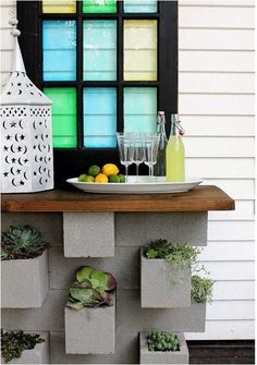 cinder blocks made into a bar! You can also make a couch out of cinder blocks with plants, throws, and magazines in the holes!