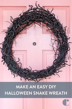 Halloween wreath DIY : Make this slithery decor for your front door. Easy DIY Halloween snake wreath using a bit of black spray paint.
