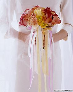 Ambiance~  An alternative to the traditional bouquet toss, cluster smaller bunches of flowers tied with a ribbon with a fortune on it.  When the bouquet breaks away, each woman who catches it will have her own fortune!~  (Photo Martha Stewart.com) (410) 819-0046  www.maryannjudy.com