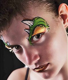 Dinosaur Jr.: Cool face paint doesn't have to be full coverage. If you're pressed for time or just want something a little more discrete, these monstrous dinosaur eyebrows are totally cool. Photo courtesy Lone Wolf Kirkegaard