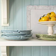 Secrets to Accessory Shopping - start with a list.  Itemize plates, bowls, glasses and anything else that could go on the shelves.  A simple color scheme as shown here in Tiffany blue, sage green and cream, creates a cohesive look.  Think pretty but practical when making purchases.