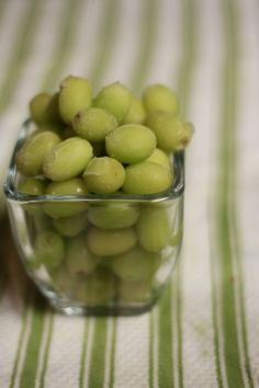 Just throw grapes in a freezer bag and freeze them lying flat so they don't all stick together.  Remove them from the freezer whenever you want an icy-sweet treat!