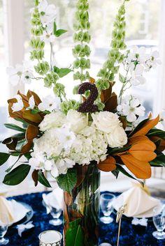 winter wedding centerpiece, photo by Merrick Rhodes Photography http://ruffledblog.com/second-notwedding-wichita #weddingideas #centerpieces
