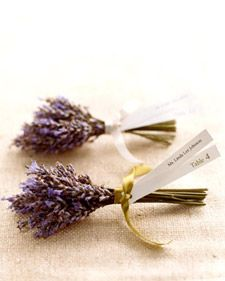 For an aromatic seating card, two strips of paper -- with the guest's name printed on one and the table number on the other -- are tied with satin ribbon to lavender wrapped with floral tape.