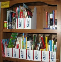 Organize all your books and magazines by making your own holders out of all those unused postal boxes! Cover them to make them prettier.