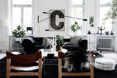 Black, white, and leather: Lotta Agaton living room stockholm house plants via Gardenista