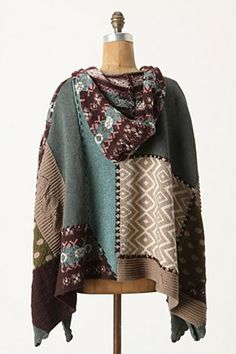 Lovely use of old sweaters. Could use similar techniques for coverlets, scarves, etc.