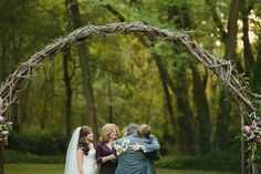 The parents brought up the bride's and groom's pieces of the Unity Cross before it was assembled. We love this sweet and sentimental photo! #unitycross #wedding #love #family