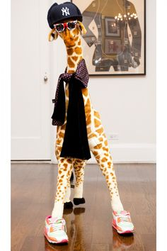 Coveteur Sneak Peek! A colorfully dressed giraffe at Ben Watts' house.