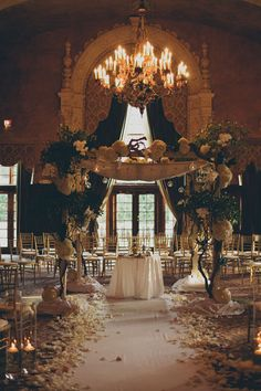 amazing wooden chuppah with orchids, wood, hydrangeas and greenery; photo: kat braman www.themodernjewishwedding.com