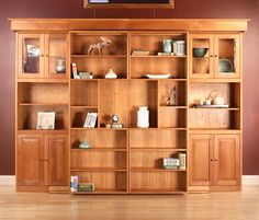 Library Wall Bed in Natural Cherry.  Central bookshelves slide to the side and a bed pulls down.  Soooo cool!