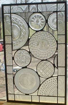 Vintage glass plate panel. Great way to use pretty plates.