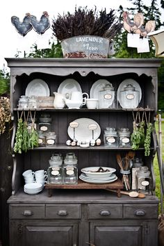 I have always wanted a Hutch like this but I think I would paint it white to go with my blue dinning room...then I fill it with pretty patterned blue and white dishes.