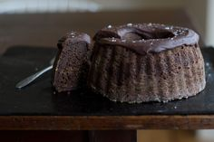 BAKE IN BBQ Chocolate Bundt Cake:    2 cups / 475 ml chocolate porter or stout beer  8 tablespoons unsalted butter, plus more for the pan  3/4 cup / 75g natural cocoa powder (non-dutched)  1 cup / 5 oz / 140 g whole wheat flour  1 cup / 4.5 oz / 125 g all-purpose flour  1 cup / 4.25 oz / 120 g muscovado or dark brown sugar  1 1/2 teaspoons baking soda  3/4 teaspoon fine grain sea salt  3 large eggs  1 1/2 cups / 355 ml plain whole yogurt  3/4 cup / 180 ml pure maple syrup