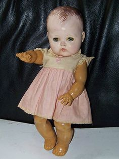 The arms and legs of this doll look like the little doll I had that my brothers destroyed to see what was inside it.  It was soft rubber.  1950 Tiny Tears