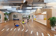 Built in Kanagawa, Japan, the Kiddy Shonan C/X Nursery houses a series of small different shaped and textured 'dwellings' functioning as classrooms or playrooms.