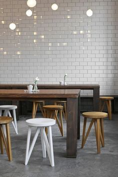 restaurant interiors, wall tiles, wood tables, bar stools, kitchen
