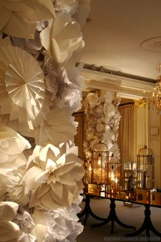 Prom decor. Column with paper covered flowers. (Could be done with make it youself columns too) Glam and savings.