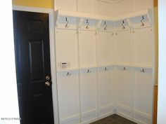 Pick a hook for your outer wear and school bags! mudroom entrance from garage or breezeway ~ Laundry room;