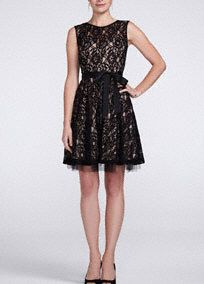 Ultra girlie and super sweet, this little black lace dress is the epitome of class and style!   Sleeveless bodice features all over delicate lace detail over nude lining.  Satin sash on waist helps create a flattering silhouette.  A line skirt adds movement and finishes off the look.  Fully lined. Back zip. Poly/nylon/cotton blend. Professional spot clean. Available in Plus sizes as Style A14209W.