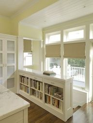 Bookshelf instead of stair railing - what an awesome upgrade for storage!.