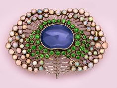 Arts and Crafts Cabochon-Cut Sapphire, Demantoid Garnet, Opal and Gold Brooch, English,  ca. 1900.